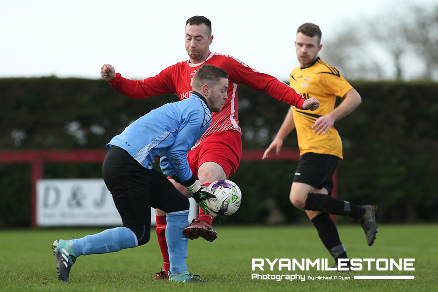 Rich McCarthy of Two Mile Borris in action against Brandon O'Callaghan of Clonmel Town during the Tipperary Cup 1st Round game between Two Mile Borris and Clonmel Town  on Sunday 9th December 2018 at Newhill, Two Mile Borris Co Tipperary. Mandatory Credit: Michael P Ryan.