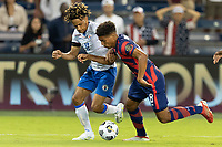 KANSAS CITY, KS - JULY 11: Nicholas Gioacchini #8 of the United States attempts to move past Roberto Louima #11 of Haiti during a game between Haiti and USMNT at Children's Mercy Park on July 11, 2021 in Kansas City, Kansas.