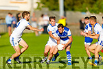 David Moran of Kerins O'Rahilly's been bottled up by Dan Cahalane and Tom Spillane of Templenoe in the Senior Club Football championship.