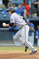 Kannapolis Intimidators first baseman Patrick Palmeiro #24 runs to first during a game against the Asheville Tourists at McCormick Field on May 10, 2013 in Asheville, North Carolina. The Intimidators won the game 5-2. (Tony Farlow/Four Seam Images).
