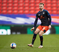 20th February 2021; Bet365 Stadium, Stoke, Staffordshire, England; English Football League Championship Football, Stoke City versus Luton Town; James Bree of Luton Town looks for the pass
