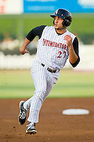 Kannapolis Intimidators third baseman Nick Basto (27) hustles towards third base against the Greensboro Grasshoppers at CMC-Northeast Stadium on July 12, 2013 in Kannapolis, North Carolina.  The Grasshoppers defeated the Intimidators 2-1.   (Brian Westerholt/Four Seam Images)