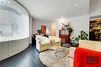 BNPS.co.uk (01202) 558833. <br /> Pic: OrlandoReid/BNPS<br /> <br /> Pictured: Reception room. <br /> <br /> A flat in a ten-storey Art Deco mansion block that was the fictional home of TV detective Hercule Poirot has gone up for rent for £1,950 a month.<br /> <br /> Grade II listed Florin Court in East London was used for filming the long-running ITV series about Agatha Christie's iconic detective.<br /> <br /> The one-bedroom ground floor flat includes a double bedroom, an open plan reception room and kitchen, and a study or home office and<br /> a marble-tiled family bathroom.<br /> <br /> The exterior of the building has strong Art Deco motifs, many of which were used in the filming of Poirot, for 24 years, from 1989 to 2013.