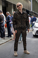 Milan,Italy - 19th june 2021 - Dolce & Gabbana fashion show for Milano fashion week Men's collection 18-22 june 2021 - young boy posing before the show on the street