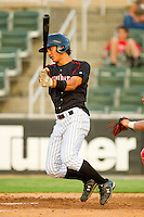 Tyler Saladino #1 of the Kannapolis Intimidators follows through on his swing against the Lakewood BlueClaws at Fieldcrest Cannon Stadium July 14, 2010, in Kannapolis, North Carolina.  Photo by Brian Westerholt / Four Seam Images