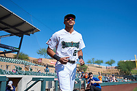 Surprise Saguaros Bubba Thompson (21), of the Texas Rangers organization, jogs onto the field during player introductions before the Arizona Fall League Championship Game against the Salt River Rafters on October 26, 2019 at Salt River Fields at Talking Stick in Scottsdale, Arizona. The Rafters defeated the Saguaros 5-1. (Zachary Lucy/Four Seam Images)
