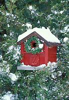 Birdhouse decorated for Christmas season with wreath