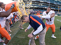 Illinois head coach Vic Koenning gets doused with gatorade by his players after winning Kraft Bowl against UCLA at AT&T Park in San Francisco, California on December 31st, 2011.   Illinois defeated UCLA, 20-14.