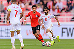 Ali Jaafar Madan of Bahrain (R) fights for the ball with Jung Wooyoung of South Korea (C) during the AFC Asian Cup UAE 2019 Round of 16 match between South Korea (KOR) and Bahrain (BHR) at Rashid Stadium on 22 January 2019 in Dubai, United Arab Emirates. Photo by Marcio Rodrigo Machado / Power Sport Images