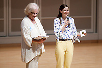 USA International Harp Competition Vice President Linda Wood Rollo, left, and Executive Director Erin Brooker-Miller speak during the Stars of Tomorrow Concert at the 11th USA International Harp Competition at Indiana University in Bloomington, Indiana on Thursday, July 11, 2019. (Photo by James Brosher)