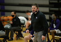 Fayetteville coach Brad Stamps directs his team Tuesday, Jan. 5, 2021, during the first half of the Bulldogs' win over Bentonville West in Bulldog Arena in Fayetteville. Visit nwaonline.com/210106Daily/ for today's photo gallery. <br /> (NWA Democrat-Gazette/Andy Shupe)