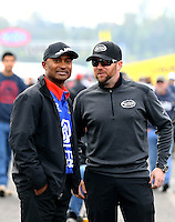 Feb 7, 2014; Pomona, CA, USA; NHRA top fuel dragster driver Shawn Langdon (right) with Antron Brown during qualifying for the Winternationals at Auto Club Raceway at Pomona. Mandatory Credit: Mark J. Rebilas-