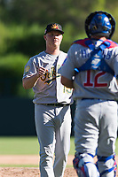 Mesa Solar Sox relief pitcher Jake Bray (15), of the Oakland Athletics organization, is congratulated by P.J. Higgins (12), of the Chicago Cubs organization, after a victory of an Arizona Fall League game against the Glendale Desert Dogs at Camelback Ranch on October 15, 2018 in Glendale, Arizona. Mesa defeated Glendale 8-0. (Zachary Lucy/Four Seam Images)