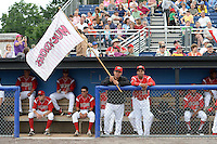 Batavia Muckdogs Victor Castro (40) holds a team flag with Wildert Pujols (38) before a game against the State College Spikes on July 3, 2014 at Dwyer Stadium in Batavia, New York.  State College defeated Batavia 7-1.  (Mike Janes/Four Seam Images)