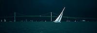 Twelve meter Columbia sails back to Newport Harbor as storm clouds darken the sky