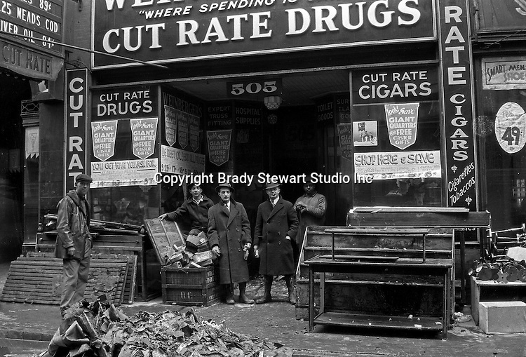 Pittsburgh PA:  Weinberger's Cut Rate Drug Store on Market Street after the flood.  About 100,000 buildings were destroyed and the damage was estimated at about $250 million. Sixty-five percent of the downtown business district had been underwater from the Point all the way up to Grant Street.
