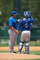 GCL Blue Jays pitching coach Juan Rincon (47) talks with pitcher Jose Nova (37) and catcher Manuel Herazo (9) during a game against the GCL Braves on August 5, 2016 at ESPN Wide World of Sports in Orlando, Florida.  GCL Braves defeated the GCL Blue Jays 9-0.  (Mike Janes/Four Seam Images)