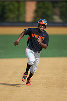 Ricky Eusebio (2) of the Miami Hurricanes hustles towards third base against the Wake Forest Demon Deacons at Wake Forest Baseball Park on March 21, 2015 in Winston-Salem, North Carolina.  The Hurricanes defeated the Demon Deacons 12-7.  (Brian Westerholt/Four Seam Images)