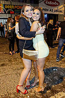 Pictured: Two young women pose for the camera in Wind Street, Swansea. Monday 31 December 2018 and Tuesday 01 January 2019<br /> Re: New Year revellers in Wind Street, Swansea, Wales, UK