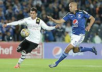 BOGOTA - COLOMBIA -15 -04-2015: Andres Cadavid (Der) jugador de Millonarios disputa el balón con Alex Stick Castro (Izq) jugador de Alianza Petrolera durante partido por la fecha 15 de la Liga Águila I 2015 jugado en el estadio Nemesio Camacho El Campín de la ciudad de Bogotá./ Andres Cadavid (R) player of Millonarios fights for the ball with xxx (L) player of Alianza Petrolera during the match for the 15th date of the Aguila League I 2015 played at Nemesio Camacho El Campin stadium in Bogotá city. Photo: VizzorImage / Gabriel Aponte / Staff.