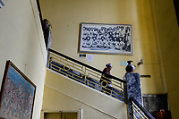 ETHIOPIA , Addis Ababa, , old palace of emperor Haile Selassie, today ethnographical museum of Institute for ethiopian studies, University of Addis Abeba, stairway with black and white photo