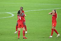 YOKOHAMA, JAPAN - AUGUST 6: Kadeisha Buchanan #3 of Canada celebrates with teammates Vanessa Gilles #14 during a game between Canada and Sweden at International Stadium Yokohama on August 6, 2021 in Yokohama, Japan.
