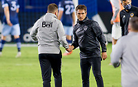 CARSON, CA - OCTOBER 18: Head coaches Marc Dos Santos of the Vancouver Whitecaps and Guillermo Barros Schelotto of the Los Angeles Galaxy  shake hands after the match during a game between Vancouver Whitecaps and Los Angeles Galaxy at Dignity Heath Sports Park on October 18, 2020 in Carson, California.