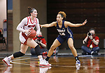 SIOUX FALLS, SD - MARCH 6: Liv Korngable #2 of the South Dakota Coyotes looks past Ariel Walker #14 of the Oral Roberts Golden Eagles during the Summit League Basketball Tournament at the Sanford Pentagon in Sioux Falls, SD. (Photo by Richard Carlson/Inertia)