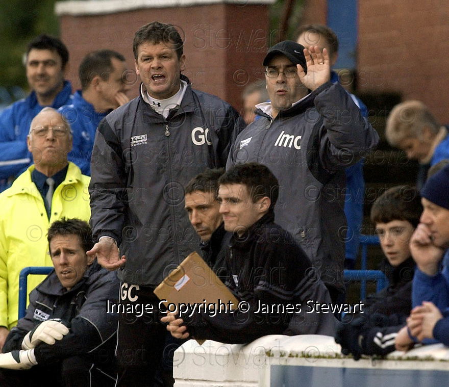 05/02/2005  Copyright Pic : James Stewart.File Name : jspa29_qots_v_dundee_utd.THE DUNDEE UTD MANAGEMENT TEAM OF GORDON CHISHOLM AND IAN MCCALL DURING THE SCOTTISH CUP 4TH ROUND CLASH AGAINST QUEEN OF THE SOUTH...Payments to :.James Stewart Photo Agency 19 Carronlea Drive, Falkirk. FK2 8DN      Vat Reg No. 607 6932 25.Office     : +44 (0)1324 570906     .Mobile   : +44 (0)7721 416997.Fax         : +44 (0)1324 570906.E-mail  :  jim@jspa.co.uk.If you require further information then contact Jim Stewart on any of the numbers above.........A