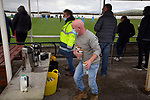 Holker Old Boys 2 Crook Town 1, 10/10/2020. Rakesmoor, FA Vase second round qualifying. A home club official in a face mask taking beers from the refreshment stand tea during the first-half as Holker Old Boys take on Crook Town in an FA Vase second round qualifying tie at Rakesmoor, Barrow-in-Furness. The home club was established in 1936 as Holker Central Old Boys and was initially an under-16 team for former pupils of the Holker Central Secondary School. Holker from the North West Counties League beat their Northern League opponents 2-1, watched by a crowd of 147 spectators. Photo by Colin McPherson.