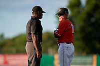 Batavia Muckdogs manager Tom Lawless (10) argues a call with umpire Tre Jester during a NY-Penn League game against the Williamsport Crosscutters on August 25, 2019 at Dwyer Stadium in Batavia, New York.  Williamsport defeated Batavia 10-3.  (Mike Janes/Four Seam Images)