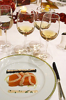 Dinner in the George V luxury restaurant in Paris. Salmon and cavia and white wine. Paris, France.