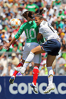 Kate Markgraf battles for a header during the USA vs Mexico's Group A 2008 CONCACAF Olympic Women's Qualifying Tournament  in Ciudad Juarez, Mexico, April 6, 2008.