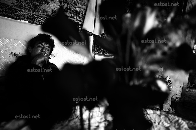 SERBIA, Belgrade, Oct. 15, 2006..Adem Smaili (35) sits in his home located in isolated ghetto-like settlement on outskirts of Belgrade, Serbia, Monday, Oct. 15, 2006. The Smaili family fled Kosovo in 1999 and are now living in a ghetto among 36 other families without electricity or water. The status of the Serbian southern province still remains unresolved while Serbia is woating on a public referendum for new Serbian constitution. © Djordje Jovanovic /EST&OST