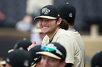 Rhyse Dee (42) of the Wake Forest Demon Deacons laughs at something one of his teammates said during the game against the Georgia Tech Yellow Jackets at David F. Couch Ballpark on March 26, 2017 in  Winston-Salem, North Carolina.  The Demon Deacons defeated the Yellow Jackets 8-4.  (Brian Westerholt/Four Seam Images)