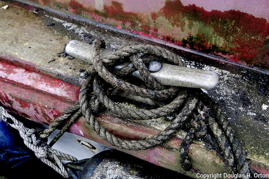 A victim of declining fisheries, this aging gill net vessel at Seatttle, WA has had it's gear removed and sits locked and forgotten at Fishermans's Terminal.