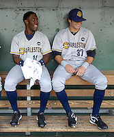 Charleston RiverDogs outfielder DeAngelo Mack (11), left, talks with outfielder Ray Kruml (37) in the dugout prior to a game against the Greenville Drive on May 27, 2010, at Fluor Field at the West End in Greenville, S.C. Photo by: Tom Priddy/Four Seam Images