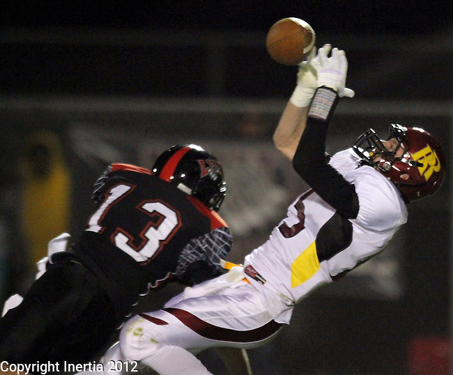 BRANDON, SD - NOVEMBER 3: Lucas Wilber #15 from Roosevelt tries to catch the football while being defended by Adam Bauer #13 from Brandon Valley in the first quarter of their Class 11AA Semifinal game Saturday night at Brandon Valley High School. (Photo by Dave Eggen/Inertia)