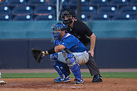 Umpire Austin Nelson and Dunedin Blue Jays catcher Ryan Sloniger (24) during a game against the Tampa Tarpons on May 7, 2021 at George M. Steinbrenner Field in Tampa, Florida.  (Mike Janes/Four Seam Images)