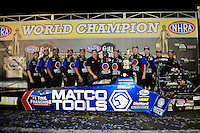 Nov. 11, 2012; Pomona, CA, USA: NHRA top fuel dragster driver Antron Brown celebrates with crew members after winning the 2012 championship during the Auto Club Finals at at Auto Club Raceway at Pomona. Mandatory Credit: Mark J. Rebilas-