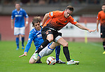 Dundee United v St Johnstone...24.08.13      SPFL<br /> Keith Watson is tackled by Murray Davidson<br /> Picture by Graeme Hart.<br /> Copyright Perthshire Picture Agency<br /> Tel: 01738 623350  Mobile: 07990 594431