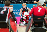 18 APR 2012 - LONDON, GBR - Canadian Garett Hickling (CAN) (Class 3.5) (centre) looks for a way through the Great Britain defence during their London International Invitational Wheelchair Rugby Tournament match at the Olympic Park Basketball Arena in Stratford, London, Great Britain (PHOTO (C) 2012 NIGEL FARROW)