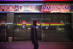 © Joel Goodman - 07973 332324 . 09/08/2011 . Manchester , UK . Piccadilly Amusements is looted , as disorder spreads to Manchester during a 4th night of rioting and looting , following a protest against the police shooting of Mark Duggan in Tottenham . Photo credit : Joel Goodman
