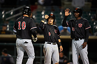 Visalia Rawhide third baseman Drew Ellis (10) is congratulated by Daulton Varsho (9) and Marcus Wilson (12) after hitting a home run during a California League game against the Lancaster JetHawks at The Hangar on May 17, 2018 in Lancaster, California. Lancaster defeated Visalia 11-9. (Zachary Lucy/Four Seam Images)