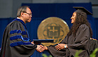 May 19, 2013;  Skylar Diggins receives her diploma from Mendoza College of Business Dean Roger Huang at the 2013 MCOB undergraduate Commencement ceremony in the Joyce Center field house...Photo by Matt Cashore/University of Notre Dame