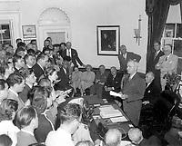 President Truman announces Japan's surrender, at the White House, Washington D.C., August 14, 1945.  Abbie Rowe. (National Park Service)<br /> NARA FILE #:  079-AR-508Q<br /> WAR & CONFLICT BOOK #:  1356