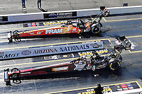 Feb. 22, 2010; Chandler, AZ, USA; NHRA top fuel dragster driver Cory McClenathan (far) races Doug Kalitta in the final round of the Arizona Nationals at Firebird International Raceway. The race is being run Monday after weather and darkness led to the cancellation of Sunday race action. Mandatory Credit: Mark J. Rebilas-