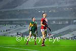 Paul Murphy, Kerry and Paul Walsh, Cork, in heavy rain during the Munster GAA Football Senior Championship Semi-Final match between Cork and Kerry at Páirc Uí Chaoimh in Cork.