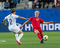 GRENOBLE, FRANCE - JUNE 15: Ria Percival #2 of the New Zealand National Team closes as Sophie Schmidt #13 of the Canadian National Team clears the ball during a game between New Zealand and Canada at Stade des Alpes on June 15, 2019 in Grenoble, France.