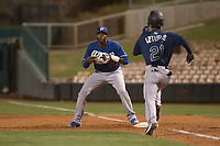 Los Angeles Dodgers first baseman Ibandel Isabel (90) prepares to catch a ball ahead of Cesar Izturis Jr. (21) during a Minor League Spring Training game against the Seattle Mariners at Camelback Ranch on March 28, 2018 in Glendale, Arizona. (Zachary Lucy/Four Seam Images)